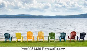 https://cdn-thumbs.barewalls.com/eight-colorful-adirondack-chairs-lined-up-on-the-beach-looking-out-on-the-lake-mountains-and-clouds_bwc9051430.jpg