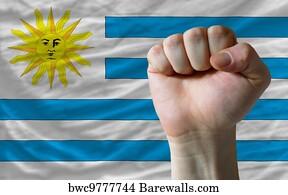 https://cdn-thumbs.barewalls.com/hard-fist-in-front-of-uruguay-flag_bwc9777744.jpg