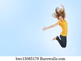 art print of pretty young woman jumping for joy barewalls posters